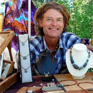 "Marcus Scott of ""The Stone Bead"" displays hand-carved stone beads that appear as though they could have been created hundreds of years ago."