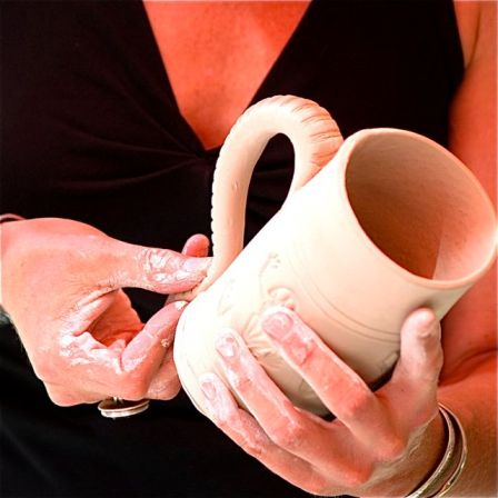 The hands of an artisan, the hands of local potter Alissa Clark.
