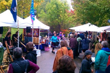 Crowds of people gather at the Lithia Artisans Market behind the plaza in downtown Ashland. As the colors change, it is the perfect time to be out and about along Ashland Creek.