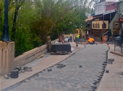 Stone masons hand paving the newly refurbished Calle Guanajuato, home of Lithia Artisans Market of Ashland, Oregon.