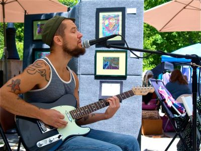 Aaron Reed of the band Bucklerash brings his soulful acoustic set to the Lithia Artisans Market. Saturday, May 10 from 11-1.