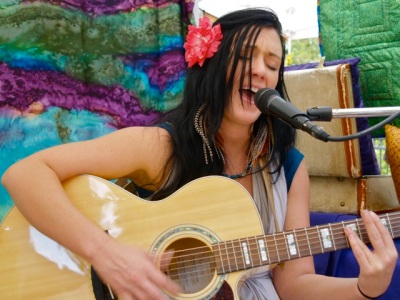 Aliana DeVictoria brings her original tunes to the Lithia Artisans Market on Sunday, October 19th from 11-1.