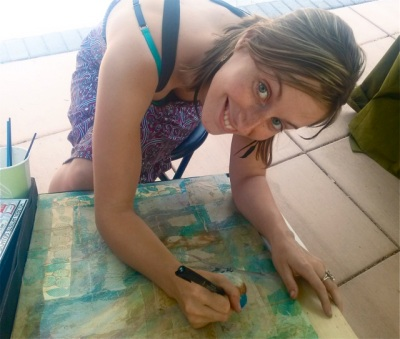 Erin Linton working on an original piece of art while in her booth at Lithia Artisans Market.