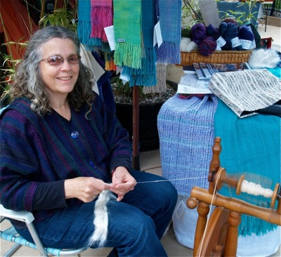 New artisan Lucy DeFranco can be found at Lithia Artisans Market spinning wool. Often set up right behind Sesame along Calle Guanajuato.