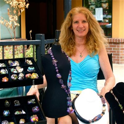 Leah Fairbanks, a very gifted lampwork glass bead artist, is the featured artisan of the week at Lithia Artisans Market of Ashland.
