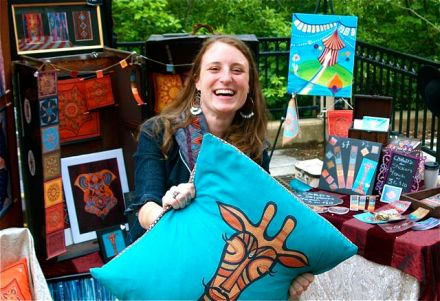 Melissa Orion, a new artist at Lithia Artisans Market of Ashland, in her colorful booth of beautiful, fun, original, archetypal art pieces.