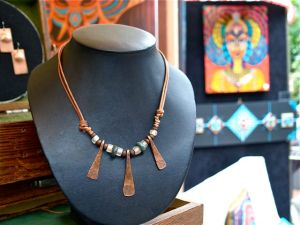 Jewelry by Marcus Scott. Forged copper pieces mixed with found jade from Northern California and old trade beads. Weekends on Calle Guanajuato, Ashland, Oregon.
