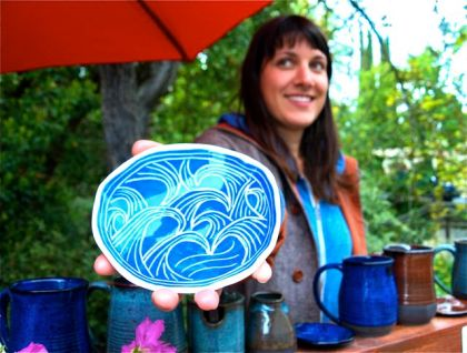 Lisa Eldredge Pottery whose image is featured on the banners that went up this week along Winburn Way.