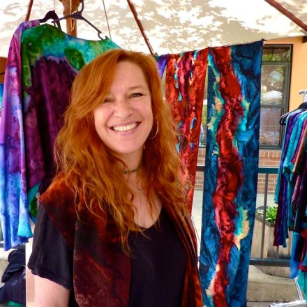 Marcella Ruikis, Hand Painted Silk Art, at Lithia Artisans Market of Ashland, Oregon. Marcella and her mom, Susan, make fabulous, richly died and hand painted silk scarves. Yummy!