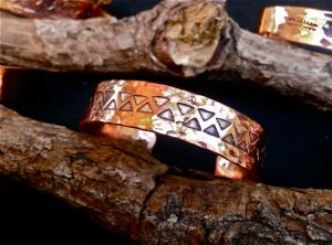 Copper bracelet by Lavelle Foos at the Lithia Artisans Market of Ashland, Oregon.