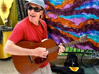 Gene Burnett plays original tunes at the Lithia Artisans Market of Ashland, Oregon.