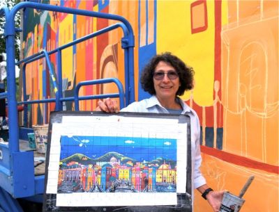 Loreta Rangel Villasenor is a Fine Artist from Guanajuato, GTO., Mexico. She has just begun the painting of a large mural on a wall that is shared with the Lithia Artisans Market of Ashland, Oregon.