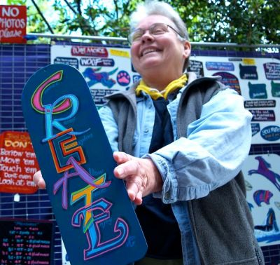 Jan Rice makes handpainted signs and magnets. She sells often at the Lithia Artisans Market in Ashland, Oregon.